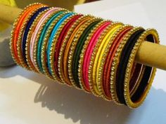 Online shopping for Silk thread bangles in India at lowest prices from Shiprocket. Shop for best selling Silk thread bangles from top sellers near you. Browse Women Jewelry products by prices, features and designs. Silk Thread Earrings Designs, Silk Thread Bangles Design, Silk Bangles, Bridal Bangles, Thread Jewellery, Gold Jewellery, Indian Jewelry Earrings, Hand Jewelry, Handmade Jewelry Designs