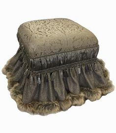 The Versailles Foot Stool combines a Soft Gray and Tan color combination that is subtle and luxurious. The Metallic Linen skirt is edged in a Faux Mink that blend perfectly with the damask pattern and