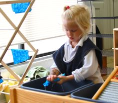 Washing the napkins after lunch.  #montessori north