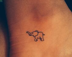 Simple, small elephant tattoo ideas #elephant #tattoo with a few music notes coming out of the trunk