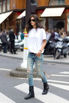 White t-shirt tucked into distressed jeans, and black boots