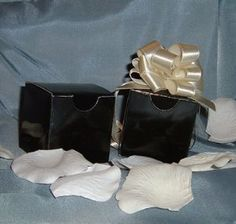 """Glossy Favor Boxes - 2""""x 2"""" x 2"""" Black - (50 pcs) Wedding/Shower/Party Favors by IGC. $18.00. Durable Glossy Favor Boxes (50 Boxes). Color as per title and picture shown. Measures 2"""" x 2"""" x 2"""". Great for all your favor packaging - just add a bow or ribbon for a touch of class. Use for Wedding favors or Bridal showers. An inexpensive way for a classic presentation. Ideal for all your gift packaging and favors .. adds a touch of class. Ships flat - (Bows or decoration show..."""