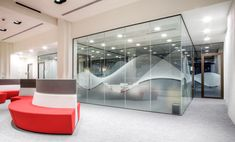 ABRSM, Salters Hall, Barbican  New offices in the iconic Salters Hall, Barbican, London.  We were asked to design the manifestation scheme as 'Abstractions of Sound'.  An optically clear white ink effect was used for the sound wave and profile cut opal frosting was incorporated for privacy.  Designed, produced & installed by LTD.