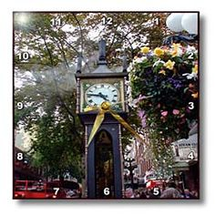 The Old Clock in Gas Town Canada with Flowers all Around it Wall Clock