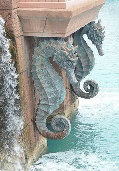 Beautiful seahorse statues form an intricate part of the architecture of Atlantis on Paradise Island, Bahamas. Paradise Island, Beach Cottages, Coastal Decor, Coastal Curtains, Coastal Bedding, Modern Coastal, Sea Creatures, Under The Sea, Statues