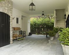 Breezeway between garage and house with stairs to a loft above the garage - lantern lights & cobblestone