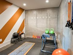 In the basement gym, the cement chalkboard wall gives homeowners a way to track weekly workouts. - HGTV Smart Home 2014 on HGTV