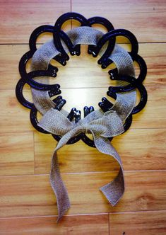Horseshoe Wreath with Ribbon. Real horseshoes welded in a Circular Position. Western Home Decor.