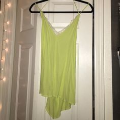 Urban outfitters tank top Silky lime green/ chartreuse top from urban outfitters with lace around trim, silence + noise size small. Never worn. Make an offer! Urban Outfitters Tops Tank Tops