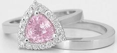 Featuring a 7mm trillion cut light pink sapphire, this ring is a one of a kind! We rarely come across trillion cut sapphires that are cut so beautifully and are this lively. This, combined with the delicate light pink hue, definitely make this sapphire look just like a pink diamond. This unique 1.59 ctw Trillion Light Pink Sapphire Engagement Set is found only at MyJewelrySource.