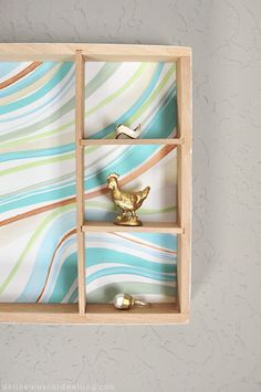 With this tutorial, you can create a piece of furniture that is not only attractive, but is useful for storage as well! This DIY Handpainted Marble Wall Box will look great in any room of your home.