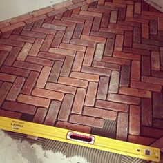 Herringbone brick floor with double border in progress