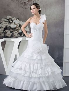 9cc5607ec93 Mermaid wedding dresses are a dazzling combination of classic glamour and  style. Satin ruffles and organza give this dress different textures and an  added ...