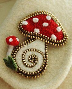 A little zipper and felt mushroom brooch