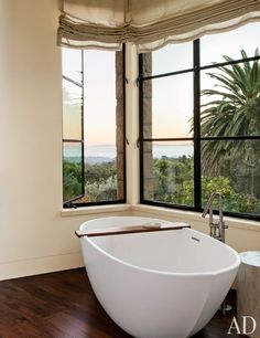 A bathroom offers ocean views from its Wetstyle tub | archdigest.com