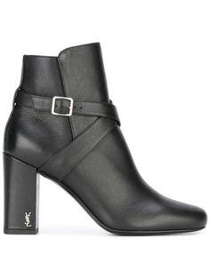 Expertly crafted to Saint Laurent's impeccable standards, these black leather Babies 90 cross strap ankle boots have been an instant hit. Set upon a sturdy and wearable high block heel, these classic ankle boots feature a slightly rounded almond toe, an ankle strap with a side buckle fastening, a brand embossed leather insole and a YSL monogram logo at the heel. Made in Italy Designer Style ID: 461713CY5NN Farfetch ID: 11796968