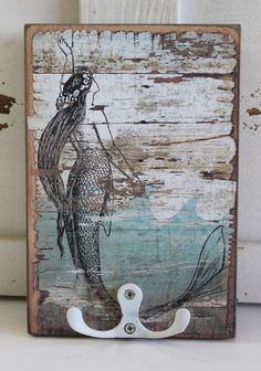 This rustic wood board with a fun Mermaid is a great place to hang your pool keys or use for a beach towel.