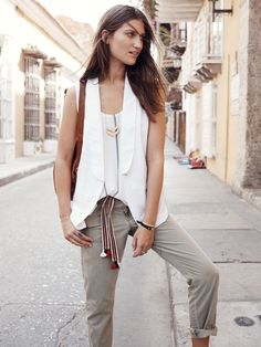 Madewell duskfall vest worn with campstitch fatigues + tassel sash.