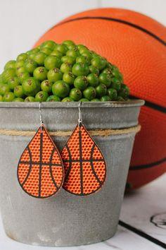 BASKETBALL leather earrings are a HUGE hit! These adorable basketball leather earrings are the perfect accessory to your fashionable outfit! Whether you love the classic teardrop, round, or a heart shaped earring, you can't go wrong with any of these choices! Click through to view even more Basketball leather earring options! #basketballteardrop #sportsleatherearrings #sportsfashion #basketballmomearrings