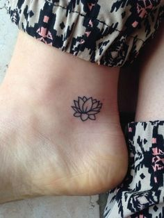 Lovely Lotus - Little Tattoo Ideas That Are Perfect For Your First Ink - Photos This would look good in white or a color.