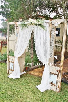 Vintage Wedding Ceremony Arch. Old doors, lace curtain, floral swag