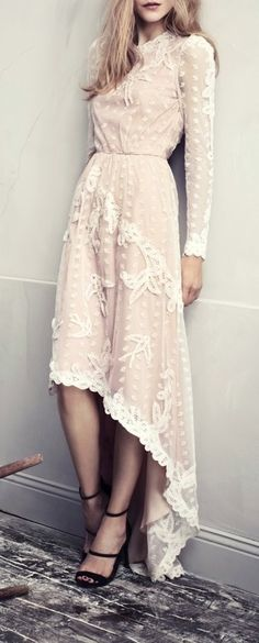 Vintage. Love the hemline