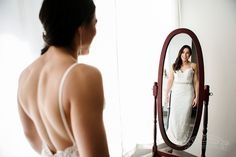 Madelis looks stunning wearing her bridal gown from Allure at Hilton-Garden-Inn-Milwaukee Bride Photography, Atrium, Looking Stunning, Milwaukee, Industrial Style, Bridal Gowns, Wedding Venues, Garden, How To Wear