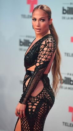 Jennifer Lopez is one of the most fashionable celebrities and she looks stunning in this black sheer dress. Jennifer Lopez Cumpleaños, Jennifer Lopez Birthday, Pictures Of Jennifer Lopez, Fishnet Dress, Sheer Dress, Celebrity Red Carpet, Celebrity Style, J Lo Fashion, Mode Chic