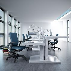 As shown here, the 'Alpha' desk frees up the perimeter of the work space and offers each opposing user the option to sit or stand.