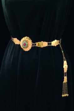 Iraqi Kurdistan | Brides belt; gold, hammered; turquoises, ruby, and glass beads | 20th century || Kurdish accessories and jewelry were made of very high quality gold, with only a few inlaid semi precious stones. In this belt, for example, some of the stones were threaded onto gold wire.