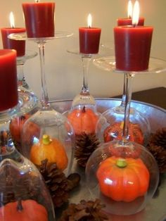 Fall candle holder idea...put baby pumpkin under upside-down wine glass; place a votive or tealight on top. Could also tie stem with raffia/ribbon, etc. Awesome idea!