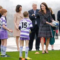 Catch! Sporty Kate showed off her rugby skills as she took part in a drill with some local children.    Photo: Getty Images