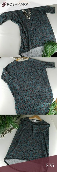 Lularoe This is a LulaRoe ,perfec T. Size XS . Short  Sleeves .High- low.96% Poly  4%Spandex RN# 142161. Tops