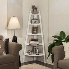 Danya B™ contemporary five shelf white bookcase space-saving design easily fits in the corners of most rooms.  The shelves narrow down from bottom to top in a fashionable ladder so you to display photo frames, books, and other decorative items.