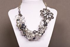 """Item 14201:  Mommy & Me Collection:  19"""" Glass pearl and faceted glass bead cluster necklace and nickel/crystal flower brooch (Blue freshwater pearls optional).  Lobster clasp $75.00"""