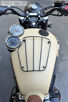 Triumph tank with molded instruments and luggage rack