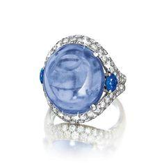 Verdura Sapphire, Platinum and Diamond Ring One 28.09 carat cabochon Ceylon sapphire, two round faceted blue sapphires and 92 round diamonds...