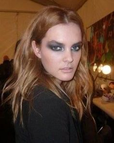 "Backstage at Diane von Furstenberg, lead makeup artist James Kaliardos created ""iridescent smoky eyes inspired by butterfly metamorphosis and peacock colors."""