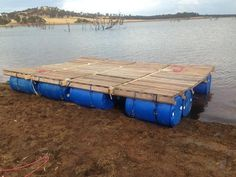 Pontoon Raft Made From Wood Pallets And 55 Gallon Plastic Drums