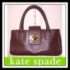 """KATE SPADE NY Choc Brown Leather Pyramid Tote Bag! KATE SPADE NEW YORK Dark Chocolate Brown Leather Pyramid Tote bag! Features: top quality pebbled leather, double handles, Kate Spade pyramid turn lock closure, beige lining, two int slip pockets & one int zip pocket. Measures 10.5"""" across X 5"""" high X 3.25"""" wide with 4.75"""" arm / hand clearance. Minor scratches on hardware. No stains, wear or damage. Excellent condition. Offers Welcome R☑️ kate spade Bags"""