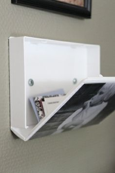 Use an old VHS tape case and create a secret compartment disguised as a picture frame.