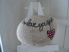 Unique hand painted Valentines love messages on Lake Erie beach stones.. $8.00, via Etsy.