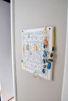 Screw a Variera shelf insert to a wall and use it to organize your jewelry. | 33 Clever And Unexpected Uses For Ikea Products