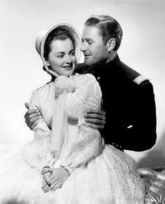 lilipopflynn:    Olivia de Havilland & Errol Flynn, Santa Fe Trail (1940).