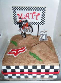 Motocross Cake - 11 Chocolate fudge cake with chocolate buttercream filling and frosting, with gumpaste banner, Fox logo and border. Dirt Bike Cakes, Dirt Bike Party, Chocolate Fudge Cake, Chocolate Buttercream, Dirt Bike Kuchen, Motocross Cake, Jake Cake, Fox Cake, Buttercream Filling