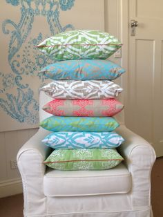 Giant stack of cushion covers from Aqua door Designs