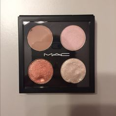 MAC Pro Palette Eyeshadow Quad Random MAC eyeshadows that have been used a few times. I de-potted these myself from the MAC containers (the $16 eyeshadows, not the $10 pans) which is why they aren't in perfect shape anymore. I'm not sure what the color names are either since I threw out the containers but the top right shadow is seedy pearl. MAC Cosmetics Makeup Eyeshadow