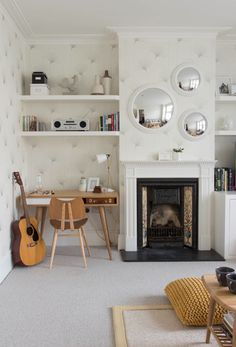 """In the absence of a dedicated home office, the next best option is to carve out some space out of another room. The most popular target? The living room, since it's a centrally located """"daytime"""" space that keeps work from bleeding into the bedroom."""