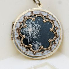 Lockets...love the way the dandelions in this imitate the look of lace... lovely and delicate.