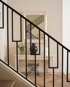 New iron railing brought style to this outdated entry as seen in Interior Appeal…